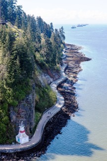 aerial photo of the Stanely Park Seawall - forest and ocean