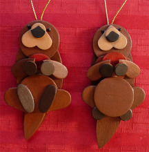 wooden Christmas ornaments shaped like otters